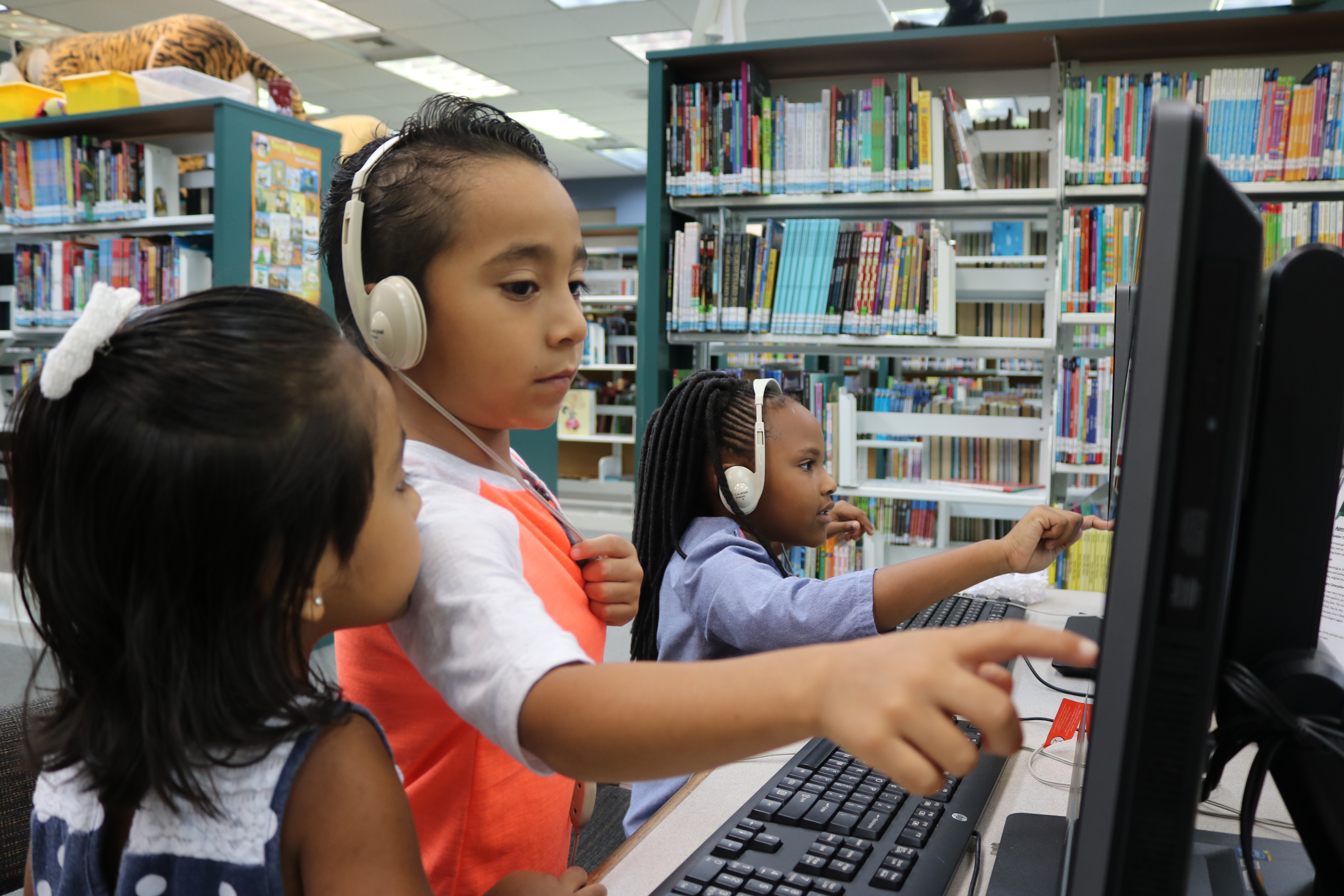 Children play on computers at Dorchester Road Regional Library